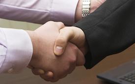 men shaking hands on a deal at Coachwest