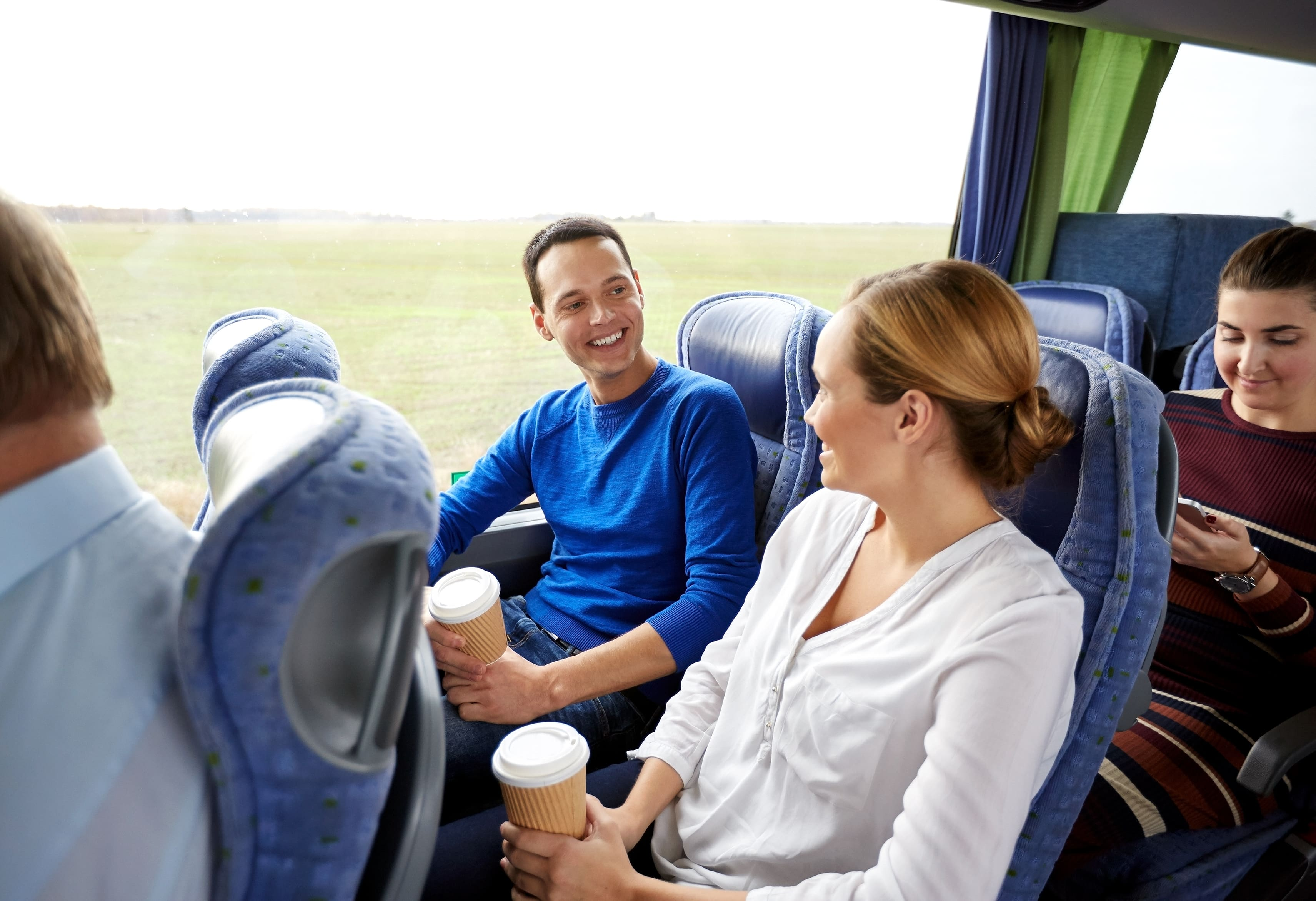 happy people in a safely-operated coach bus