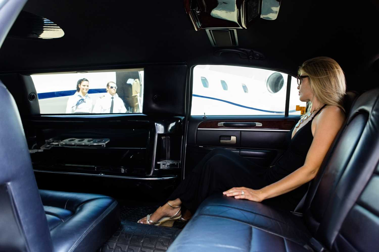 woman sits patiently in an SUV Limo from Coachwest