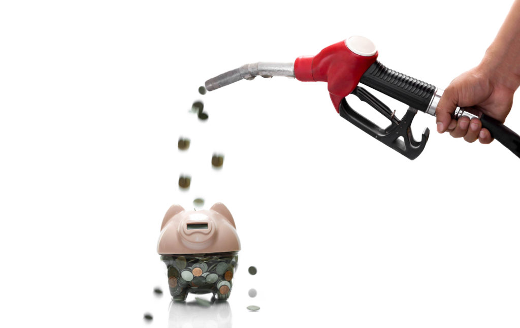 Gas pump pouring coins into a piggy bank — representing gas savings in your Sprinter Van.