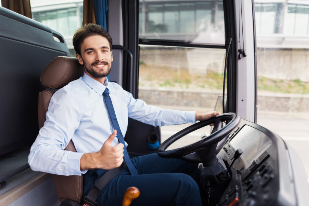 Happy coach bus driver