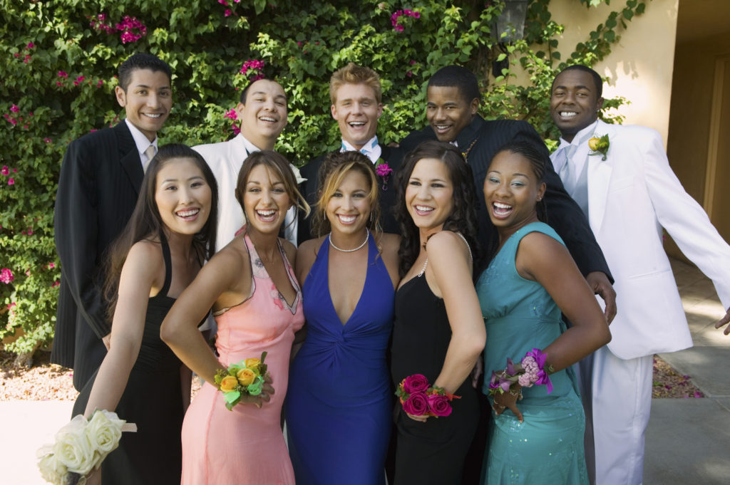 Group preparing for limo bus to arrive before prom