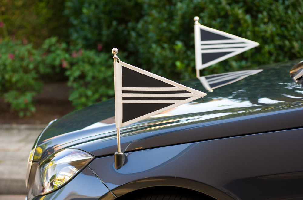 Funeral Car with Mourning Flags