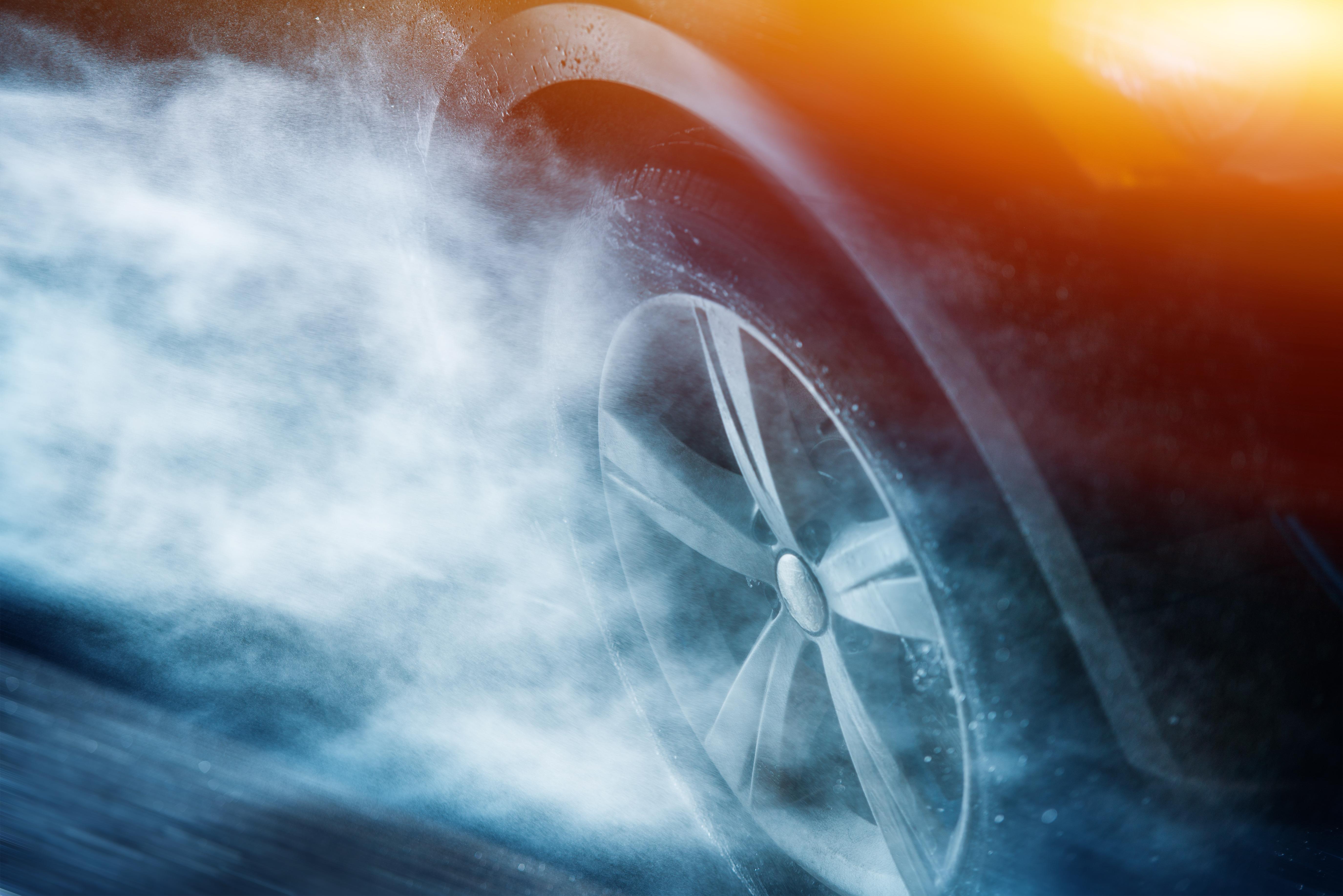 Close up of wheel of car in heavy rain