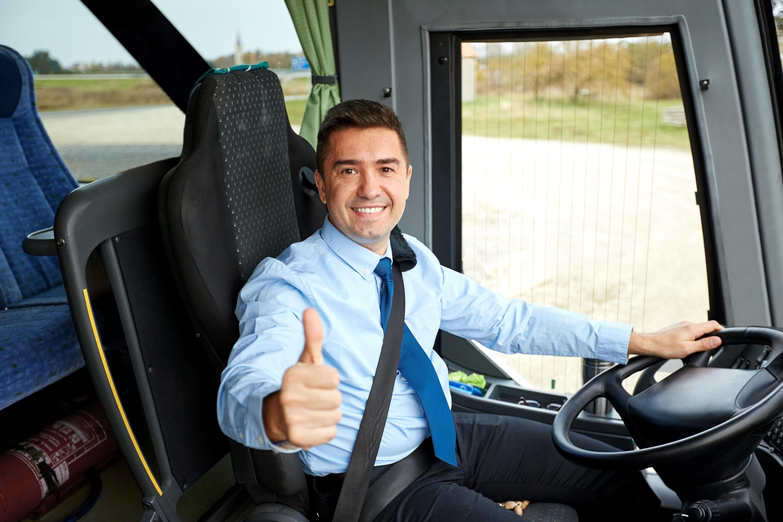 Man driving a coach bus