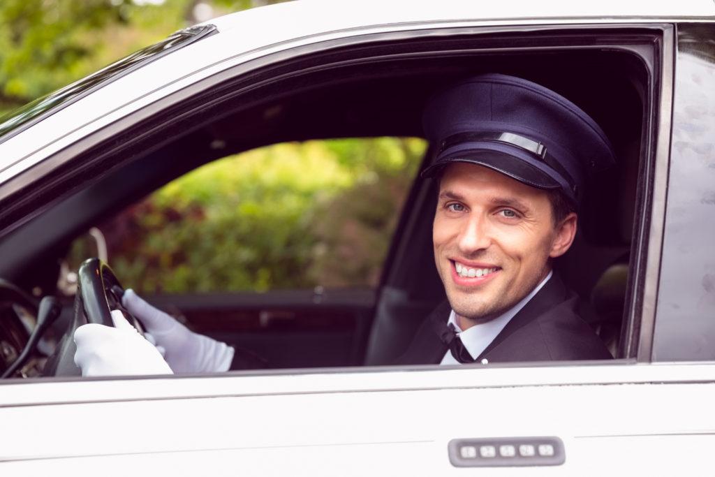 A limo driver smiles.