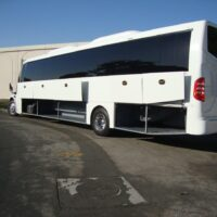 2020 Freightliner Executive Bus Builders SuperCoach 45 XL Driver's Side Cargo Compartments Open 3/4 View